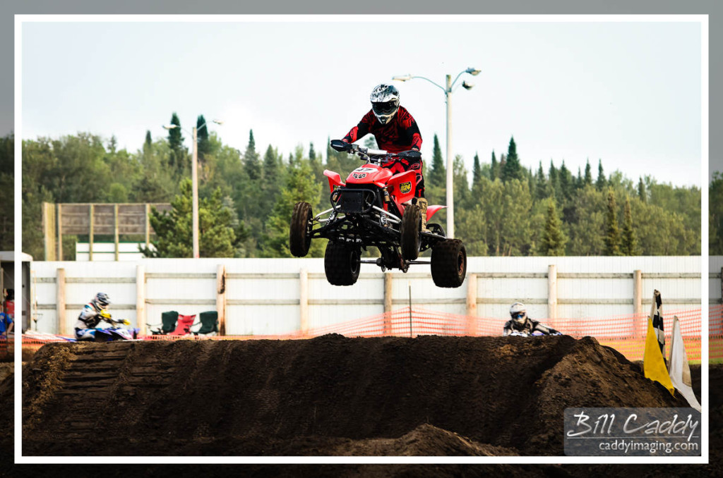 Catching air in the quad race.